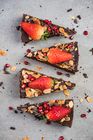 Sweet chocolate brownie slices, top view.