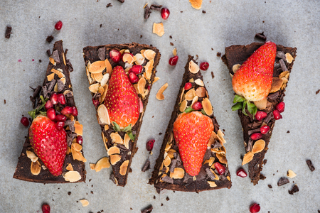 Triangle slices of healthy chocolate brownie. Stock Photo