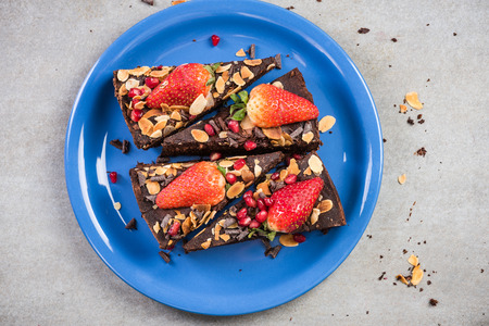 Strawberry and chocolate brownie sliced on plate