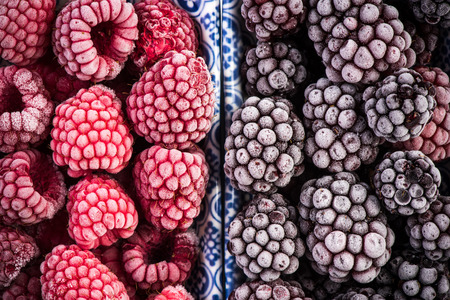 Frozen blackberry and raspberry fruits, close up. Stok Fotoğraf