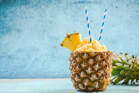 Tropical juice granita served in pineapple, copy space. Stock Photo