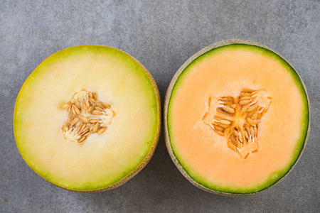 Honeydew and cantaloupe melons halves, top view. Archivio Fotografico