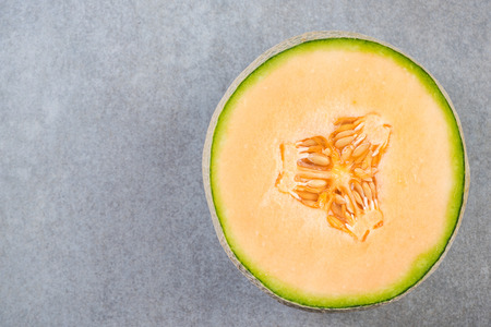 Yellow melon sliced in half, copy space,