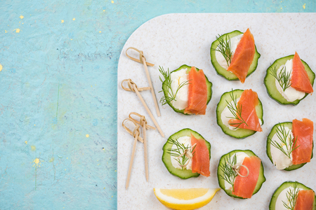 Smoked salmon, cottage cheese and cucumber snack for garden party.