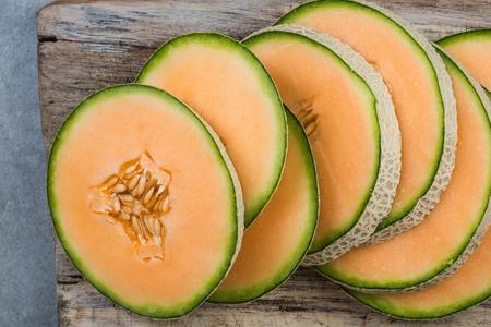 Cantaloupe melon slices on board. Stock Photo