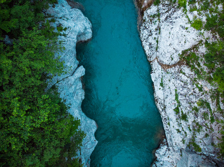 Rocks anf forest along Soca river, drone top down photo,Slovenia