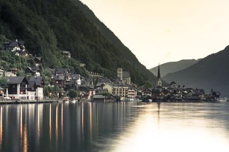 Sunrise in  famous Hallstatt mountain village with Hallstatter lake. Stock Photo