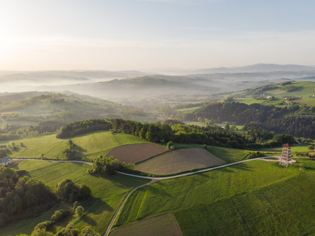 Beautiful aerial view over hills at sunrise.
