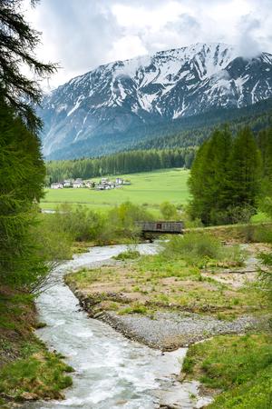 Wild river in Switzerland rural alpine landscape.