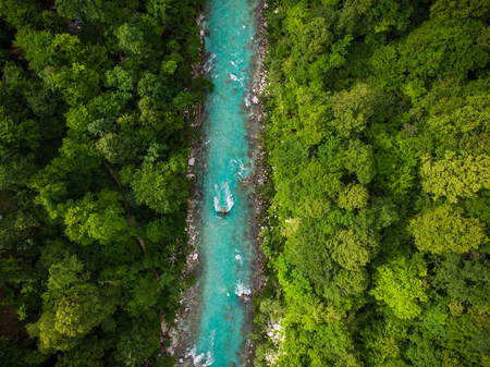 Symmetric pattern of Soca river and forest, aerial drone photo.