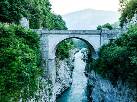 Napoleons Bridge over river Soca, Slovenia, aerial drone view. Фото со стока
