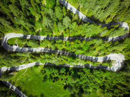 Beautiful scenic serpentine road in Slovenia Alps. Aerial view. Road trip concept.