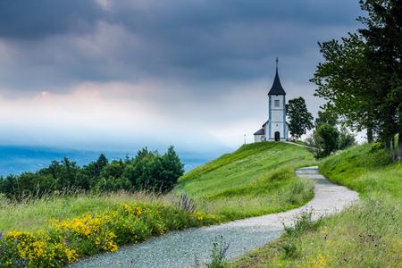 Beautiful sunrise at Church of St. Primus and Felician, Jamnik, Slovenia .