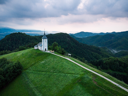 Aerial view over Lonely Chapel of  St. Primus and Felician, Jamnik, Slovenia Stock Photo