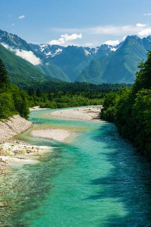 Soca river in Slovenia with Julian Alps in background.