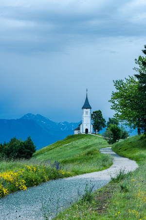 Evening at Church of St. Primus and Felician, Jamnik, Slovenia Stock Photo