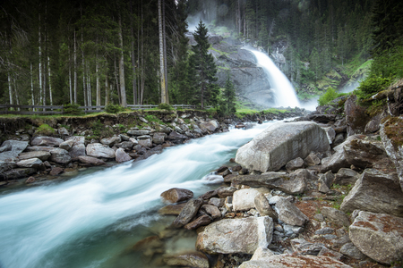 Fast flowing river and Road to Krimml Waterfalls in , Austria.