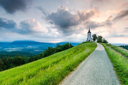 Romantic village, Church of St. Primus and Felician, Jamnik, Slovenia Stock Photo - 102745315
