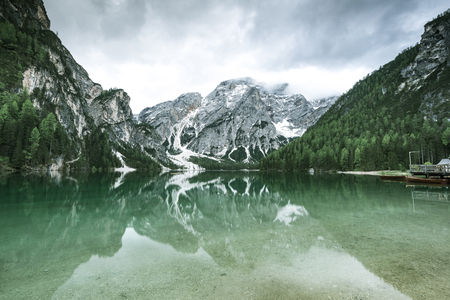Reflection in Pragser Wildsee or Braies Lake in Italy.