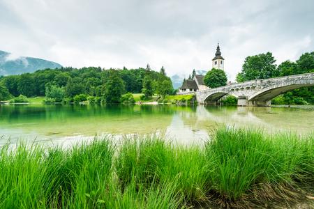 Church of Sv. John the Baptist  by the Bohinj lake, Slovenia Stock Photo