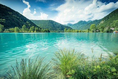 Emerald green water at Most na Soci Lake in Slovenia.