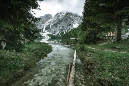 Wild stream in Pragser Wildsee or Braies Lake in Italy. Stock Photo