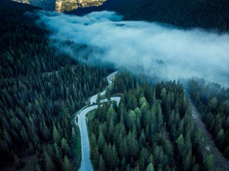 Alpine asphalt road from aerial drone view. Banco de Imagens