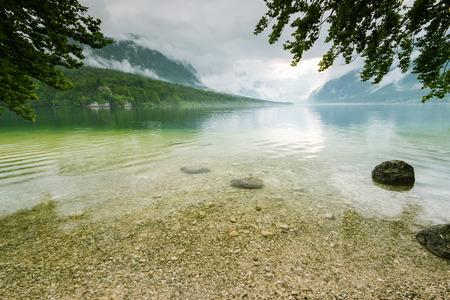 Clear water of Bohinj Lake, Slovenia. Фото со стока