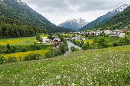 Village in valley in Switzerland at summer time.