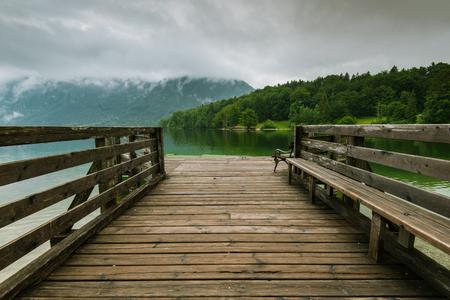Wooden pier leading into Bohinj Lake, Slovenia.