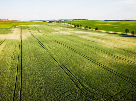 Aerial drone view of rolling hills and farmland.