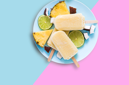 Fruit popsicles ice cream on pastel background, flat lay design.