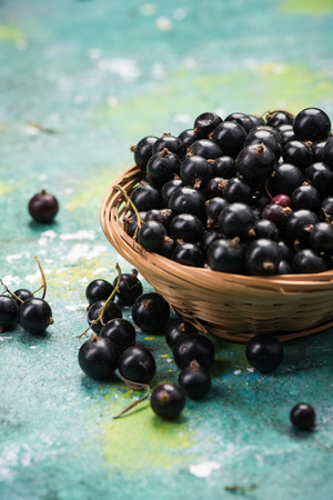 Fresh ripe blackcurrant in basket. Stock Photo