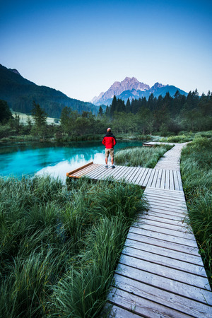 Man looking at view in Zelenci Park, Slovenia.