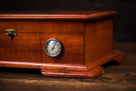 Wooden humidor for storage cigars.