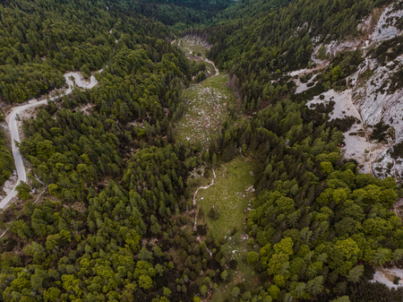Aerial drone view over road in high mountains Julian Alps