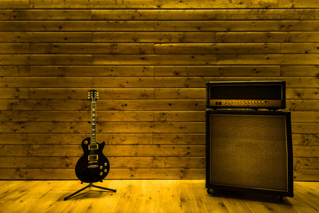 Music studio with guitar and amplifier, copy space template 스톡 콘텐츠