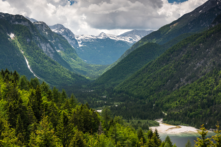 Amazing view ower mountains and woodlands in Italian Alps