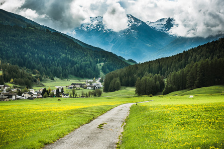 Rural road ito mountain village in Switzerland Stock Photo