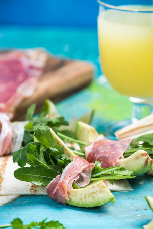 Healthy brunch, avocado wrapped in ham and salad Stock Photo