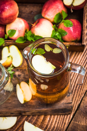 Jug with freshly made pressed apple juice