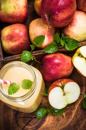 Apple juice in jug with mint Stok Fotoğraf