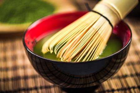 Bamboo whisk making Matcha green tea