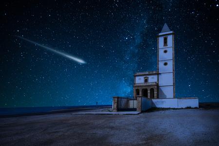 Perseid Meteor Shower and the Milky Way over castle over church La Almadraba de Monteleva,Spain Stok Fotoğraf