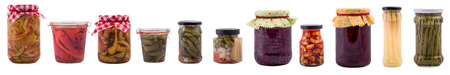 Wide banner with preserved food in jars, isolated on white Imagens
