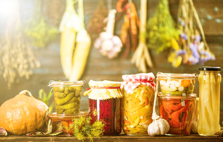 Pickled Marinated Fermented vegetables on shelves in cellar