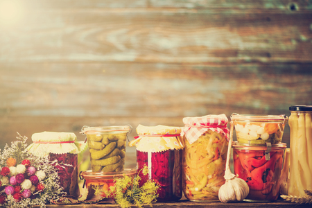 Preserved food, marinated fermented and pickled vegetables in jars