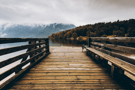 Wooden pier at autumn lake, fall colors Stock fotó