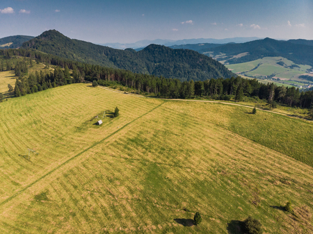 Green farming hills and meadows in Pieniny, aerial view