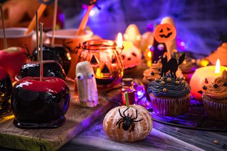 Sweet treats at Halloween table, party food. Фото со стока